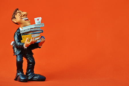 profile of man carrying books figurine