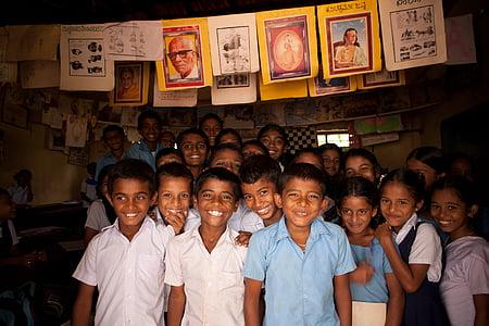 children standing inside room
