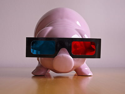 pink ceramic coin bank wearing blue, red, and black 3D glasses