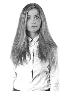 grayscale photo of woman in dress shirt