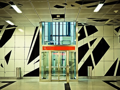 photo of clear glass elevator