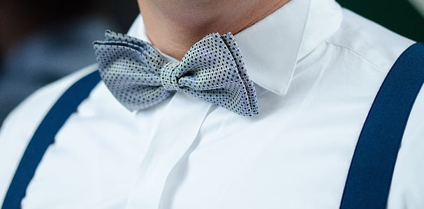 man in grey and black bow tie