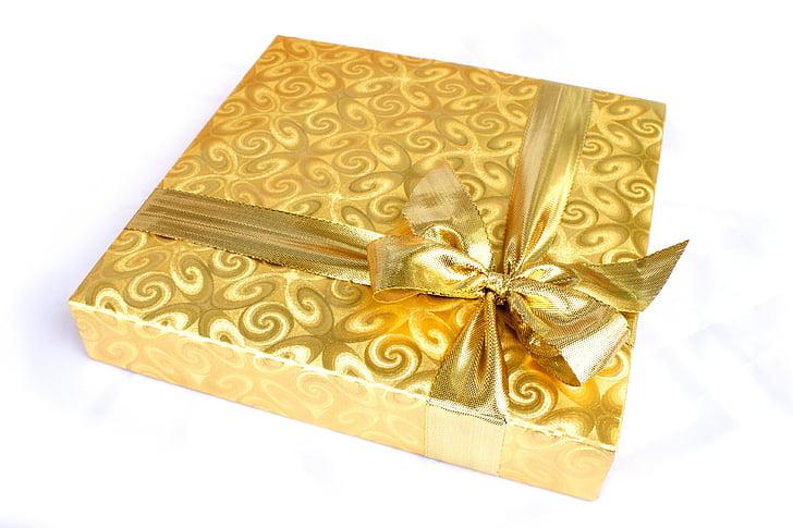 gold gift box with ribbon