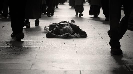 man lying on floor during daytime