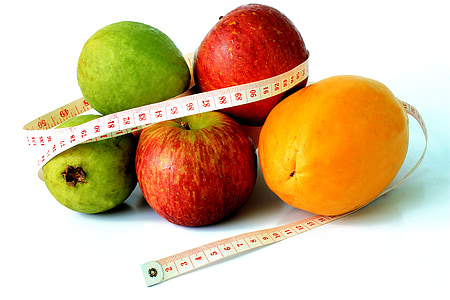 variety of fruits with tape measure
