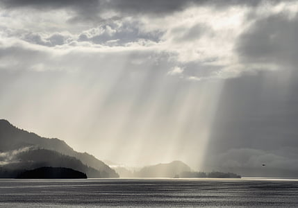grey scale photography of sun rays