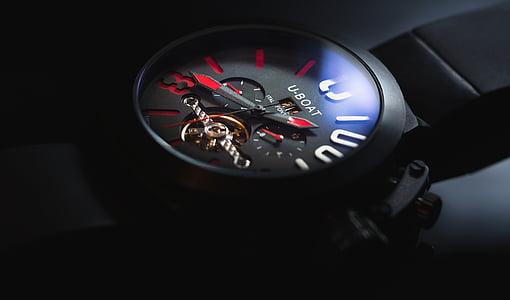 round black U-Boat chronograph watch with black strap
