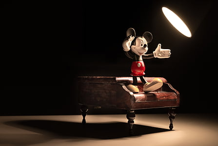 Mickey Mouse figure standing on grand piano miniature
