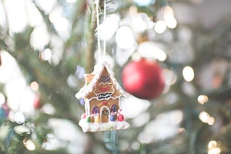 bokeh photograph of gingerbread house ornament
