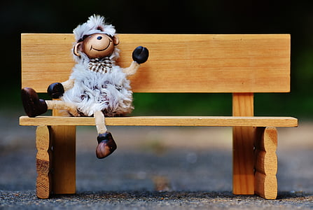 monkey doll sitting on bench