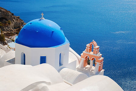 white and blue dome building near body of water
