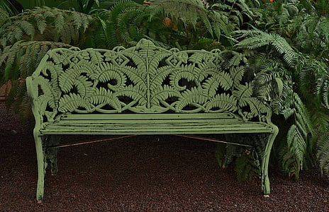 white wooden bench beside green leafed plant