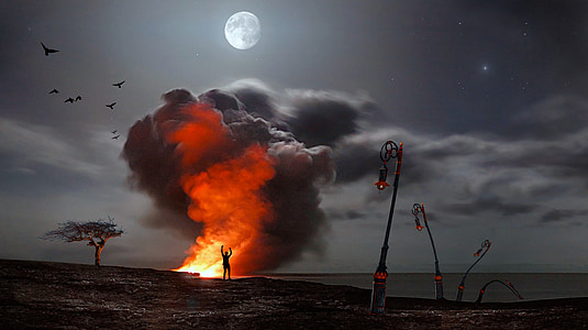 silhouette of person standing near flame under full moon digital wallpaper
