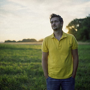 men's yellow polo shirt and blue jeans