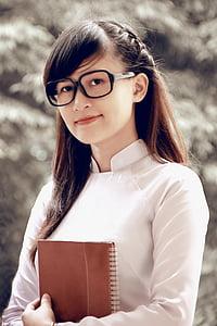 shallow focus photography of smiling woman wearing black eyeglasses