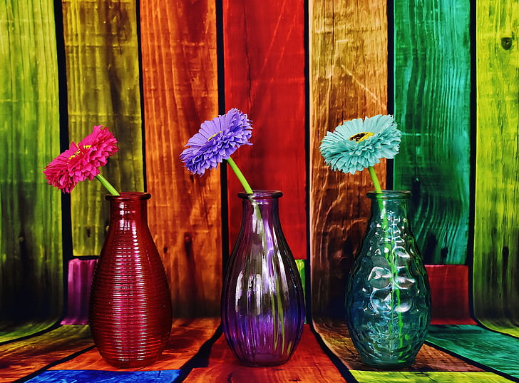 Royalty Free Photo Three Assorted Color Petaled Flowers With Glass