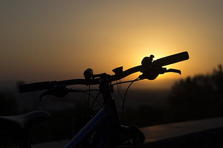 silhouette of bicycle during golden hour