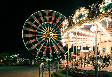 ferris wheel and carousel at night