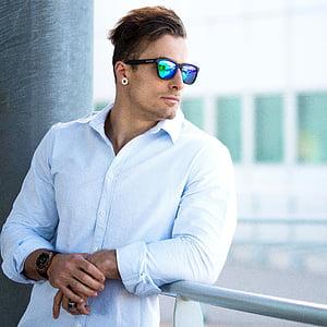 man in black framed sunglasses and white dress shirt