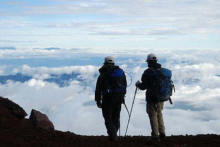 men standing on mountain