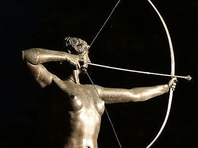 person holding bow and arrow statue