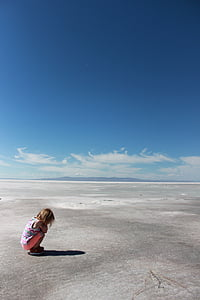 girl sitting on gray surface