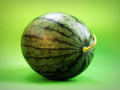 green watermelon on green surface
