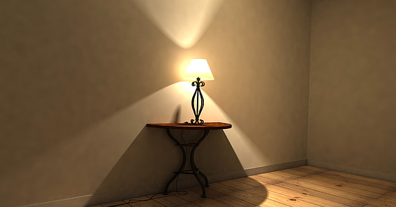 brown wooden side table with black table lamp on top