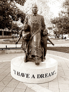 man and two boys statue
