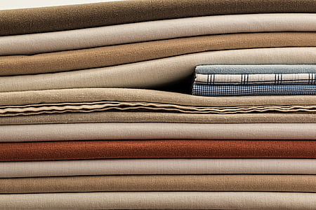 pile of assorted-color textiles