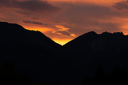 silhouette photography of mountains during golden time