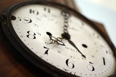 round wall clock at 7 o'clock
