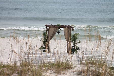 brown wooden marriage arc on seashore