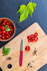 photo of tomatoes and kitchen knife