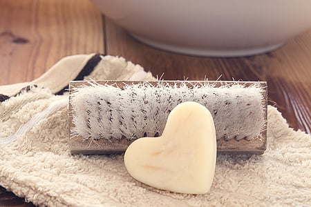 closeup photo of heart white soap and brush