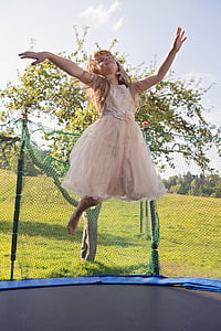 photo of girl jumping on trampoline