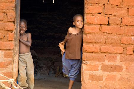two boys on doorway