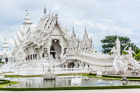 photo of white temple near body of water