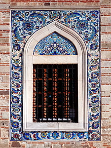 window with blue floral wall tile