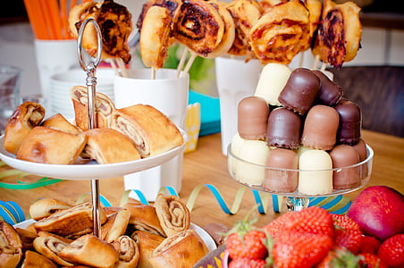 variety of pastries and strawberries on table