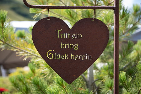 white text on brown heart backgrou d