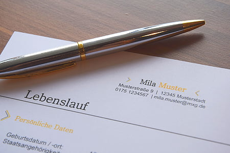 twist pen on Mila Muster personal data on table