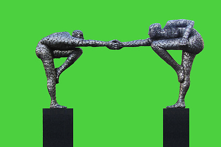 photo of two men holding hands figurine