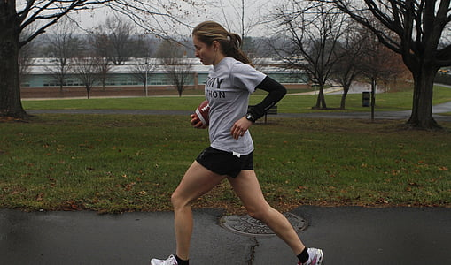 photo of woman wearing gray shirt