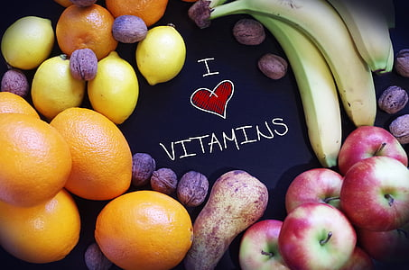 i love vitamins text surrounded by assorted fruits