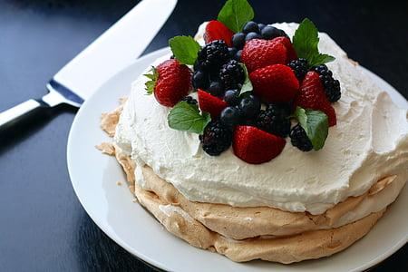 strawberry cake on white plate near stainless steel cake server