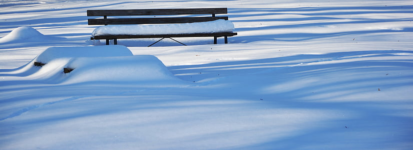 bench surrounded by snow