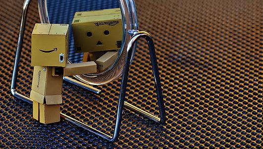 cardboard box robot facing mirror