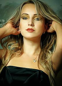 woman in black strapless dress portrait