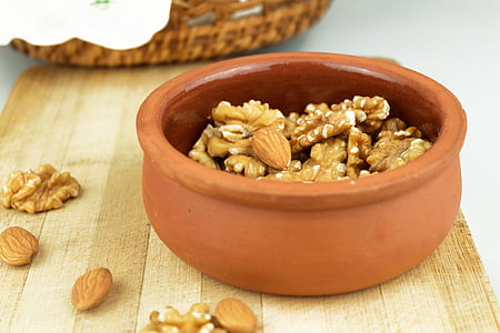 photo of brown almond brittles in brown clay pot